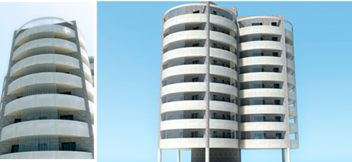 Proyecto edificacion torre de 24 viviendas, ubicado en Argelia. Formada por tres volumenes cilindricos y con superficies de viviendas comprendidas entre los 80 y 100 m2 construidos y amplias terrazas. Fachada de ladrillo caravista y mortero monocapa blanco.
