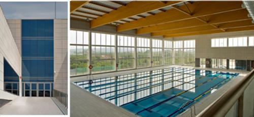 Proyecto edificacion fachada ventilada con acabado euronit y muros cortina. 6039 m2 construidos. Estructura, losa de cimentación, forjados de hormigón y vigas de madera laminada encolada.